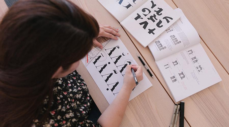 Brígida working on fonts from KOBU Foundry